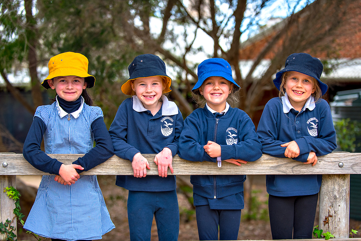/uploaded_files/media/gallery/1568690493Girls lined up against fence 234.jpg